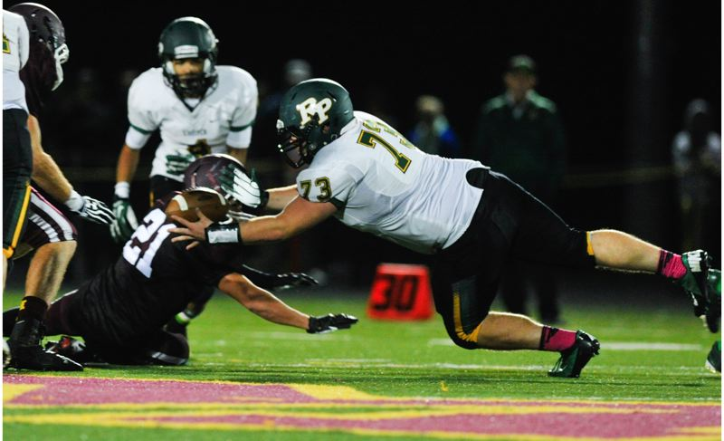 by: JOHN LARIVIERE - Putnam sophomore defensive lineman Zack Mason (73) dives to recover a Mustang fumble in last Fridays game at Milwaukie. It was a long night for the Mustangs, who committed no fewer than eight turnovers in a 35-0 losing effort.