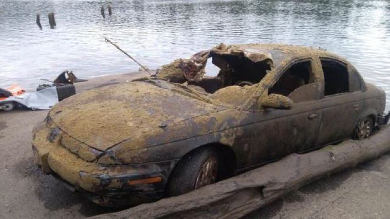 by: PHOTO BY: KOIN 6 NEWS - This Saturn was found in the Willamette River near the Oak Grove boat ramp, along with five other cars in August.