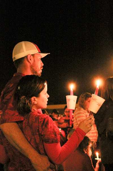 by: NEWS-TIMES PHOTO: JOHN SCHRAG - Parents brought their children to the Candlelight Ceremony at Sonrise Church Monday night as family members across Forest Grove hugged each other and struggled together to process the deaths of two young girls.
