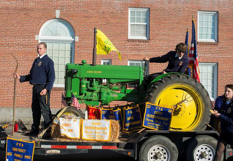 by: NEWS-TIMES PHOTO: CHASE ALLGOOD - Forest Grove FFA members display their awards alongside an agricultural tableau.