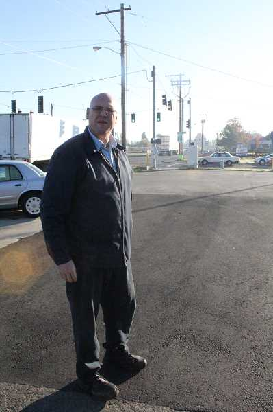 by: JEFF MCDONALD  - Kevin Baker, co-owner of Baker & Baker Towing Service in Woodburn, is looking to redevelop his lot as the Woodburn Interchange Project is under way.
