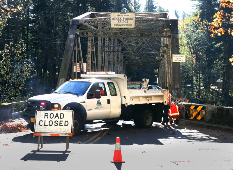 by: OUTLOOK PHOTO: JIM CLARK - Fog and speed may have played roles in a crash involving a trucks trailer and the Stark Street Bridge  over the Sandy River on Monday morning, Oct. 21. The bridge was inspected by Multnomah County bridge engineers and reopened early Monday afternoon.