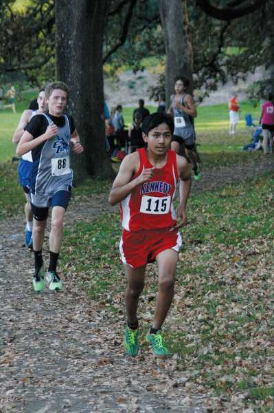 by: PHIL HAWKINS - Sophomore Adrian Parra set the school's record for a sophomore when he finished fourth with a time of 16:58.7. Together, Parra and Susee helped the Trojans finish in second place in the team standings at Thursday's race in Salem.