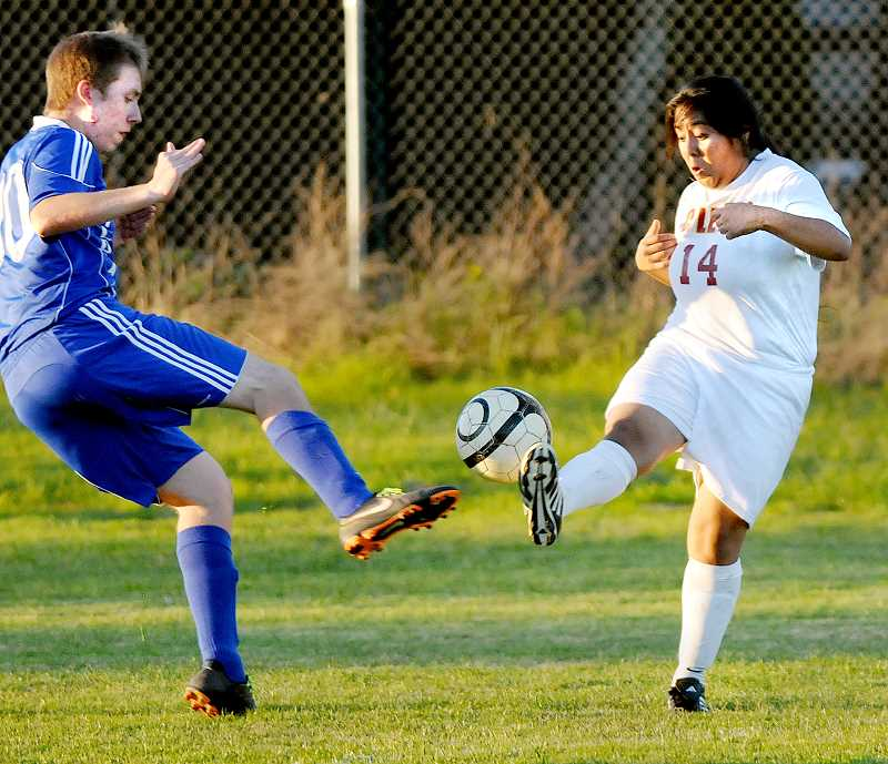 by: SETH GORDON - Playoff bound -- Tajanae Perkins controls the ball during C.S. Lewis Academy's 4-0 win over Southwest Christian Monday in Newberg. The victory propelled the Watchmen into third place in the final 3A/2A/1A Special District 5 standings and ensured a spot in the league's four-team playoff.