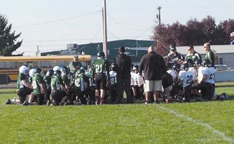 by: FENYA USOLTSEFF - The Gervais and Salem Academy football teams kneel in prayer for Diego Rodriguez.
