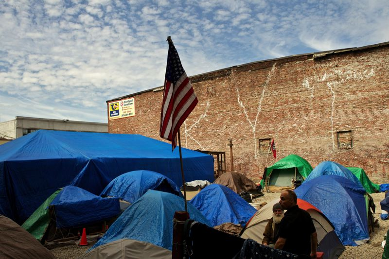 by: TRIBUNE FILE PHOTO - Right 2 Dream Toos move to a parking lot beneath the Broadway Bridge has been delayed as organizers meet with Pearl District representatives hoping to find an alternate site for the homeless campers.