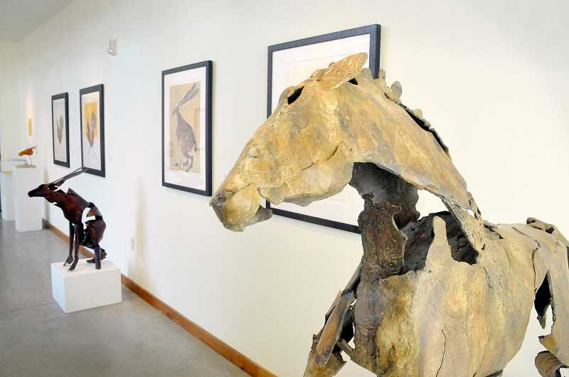 by: GARY ALLEN - Melding mediums -- Danae Miller, featured at Minthorne Gallery at George Fox University until Nov. 1, creates pieces in two different    mediums. This show, 'Natural Reflections,' depicts realistic yet interpretive animals using bronze and glass and prints.