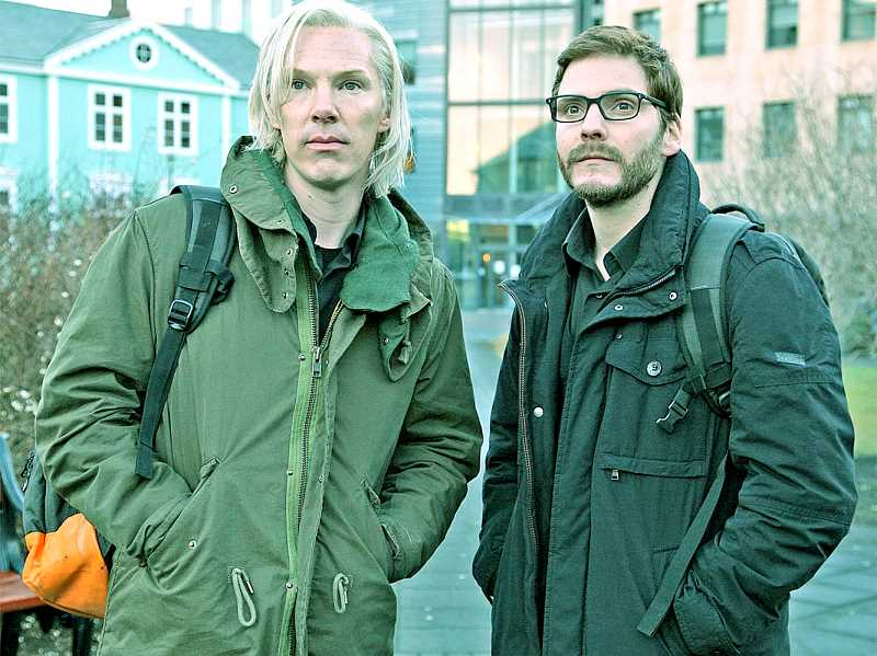 by: PHOTO COURTESY OF DREAMWORKS PICTURES - Powerful -- Benedict Cumberbatch (left) and Daniel Bruhl portray real-life hacker activists Julian Assange and Daniel Berg in 'The Fifth Estate.'