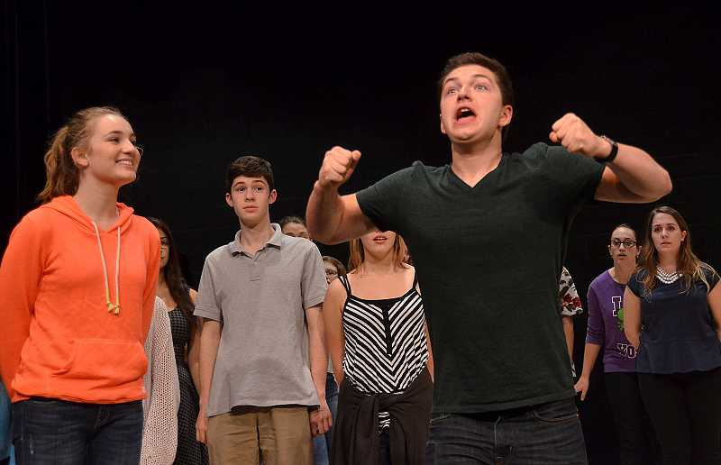 by: REVIEW PHOTO: VERN UYETAKE - Steve Rathje rehearses with his fellow students while preparing for next months production of Honk! at Lake Oswego High School.