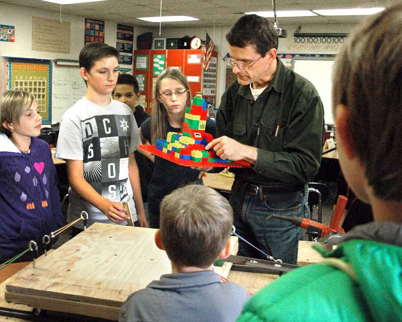 Photo Credit: ISABEL GAUTSCHI - Structural Engineer David Bugni gives Eagle Creek Elementary students some pointers on structural soundness. Bugni had demonstrated the affects of earthquakes on buildings as part of the school's after school Science Technology Engineering Arts and Mathematics (STEAM) program.
