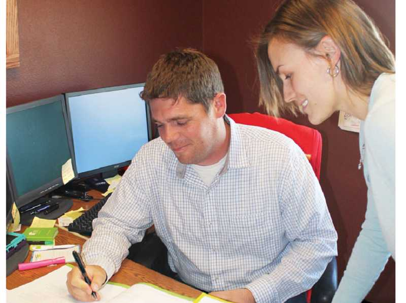 by: HOLLY M. GILL - Martti Rahi and Kayla Whitaker, agents at PayneWest Insurance, of Madras, are assisting people who signing up for insurance under the Cover Oregon program.