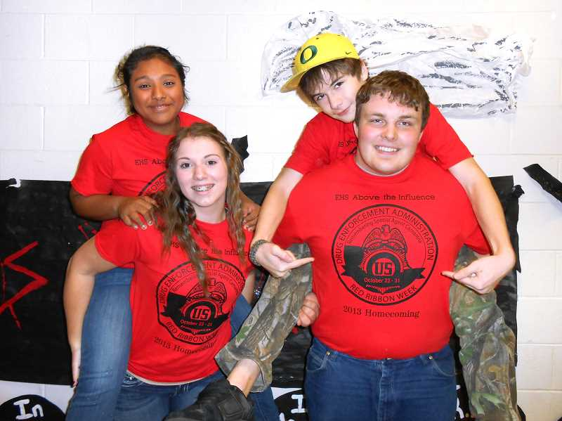 by: CONTRIBUTED PHOTO: SONJA MCCARTY -  Lucy Naal-Colli (back left), Chris Moore, Cassie McGuffeys (front left) and Chris Benson show off their Red Ribbon Week T-shirts.