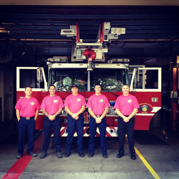 by: PHOTO COURTESY: CLACKAMAS FIRE - Clackamas firefighters at Station 15 in Oregon City proudly don their pink T-shirts for breast-cancer awareness.