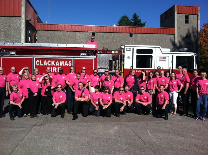 by: PHOTO COURTESY: CLACKAMAS FIRE - The entire Clackamas Fire administrative staff and Station 1 crew at Fuller Road east of Milwaukie gather for their pink photo-op on Oct. 23.