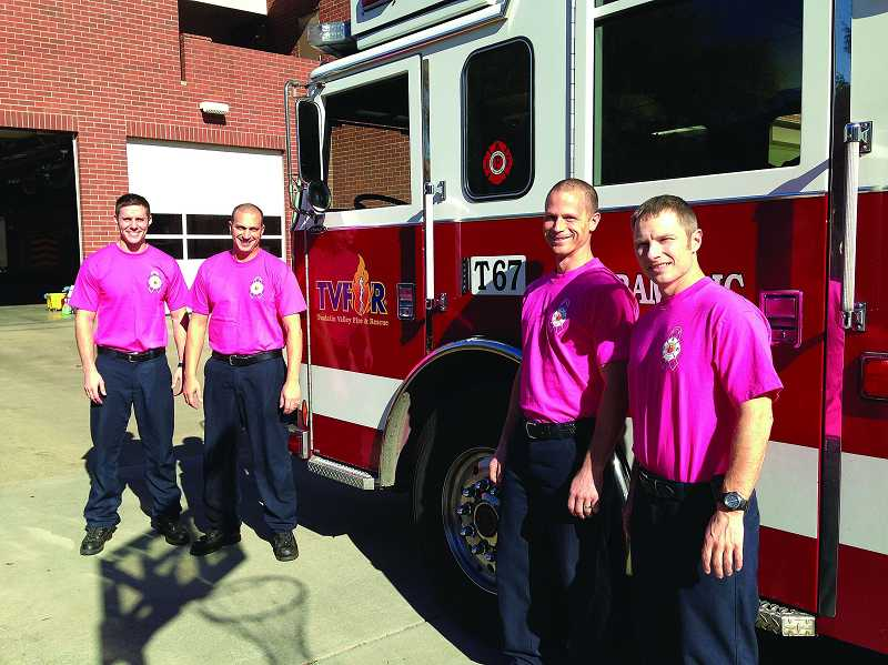 by: SUBMITTED PHOTO: TVF&R - Tualatin Valley Fire & Rescue firefighters from Beaverton Station 67 will continue to wear pink T-shirts through Friday to raise awareness about breast cancer.