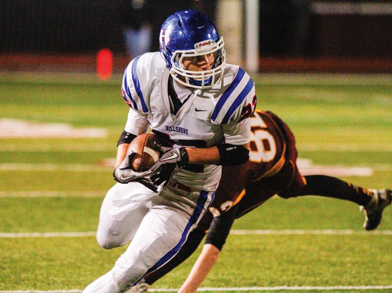 by: HILLSBORO TRIBUNE PHOTO: AMANDA MILES - Hillsboro senior running back Michael Gaskell looks for running room during last Friday's Pacific Conference game against Forest Grove.