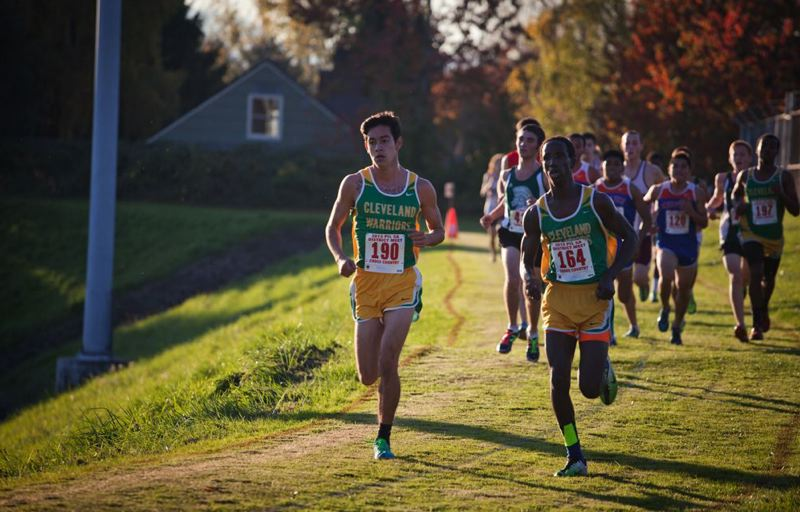 by: TRIBUNE PHOTO: ADAM WICKHAM - Cleveland runners Alex Nova (left) and Nabi Amin take the lead in the PIL 5A boys cross-country championships. The Warriors captured the league title, with their first five runners in the top 14. Nova was sixth, and Amin placed first.