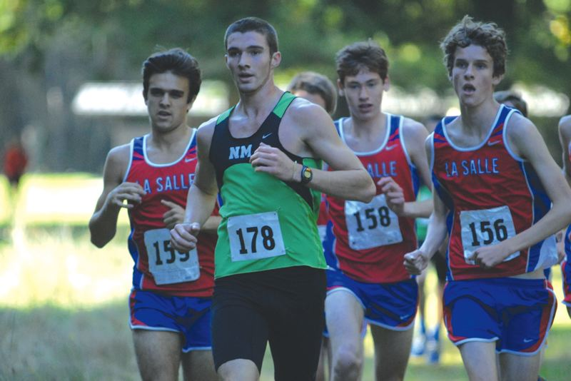 by: DAVID BALL / PAMPLIN MEDIA GROUP - North Marion senior Christian Parr runs Oct. 23 at McIver Park during the Tri-Valley Conference district meet, leading a group of La Salle Prep runners at the 1-mile marker.