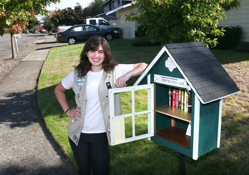 by: OUTLOOK PHOTO: JIM CLARK - To earn her Girl Scout Gold Award, 18-year old Claire Palmiter designed and supervised the assembly of four Little Free Libraries, like this one in Southeast Gresham.