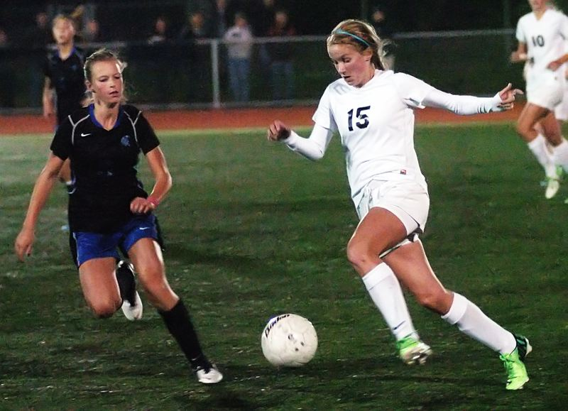 by: DAN BROOD - IN A HURRY -- Tigard sophomore Natalie Bryant (right) looks to get the ball upfield against a Hillsboro defender in last week's match. The Tigers won 3-2 to move into first.