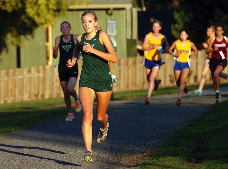 by: DAN BROOD - LEADING THE WAY -- Tigard junior Elizabeth Dean sets the pace during last week's Pacific Conference meet held at Tualatin High School.