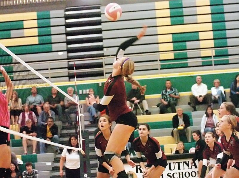 by: DAN BROOD - SMACK IT -- Sherwood senior Hannah Valesano goes up for a kill during Tuesday's match at Putnam.