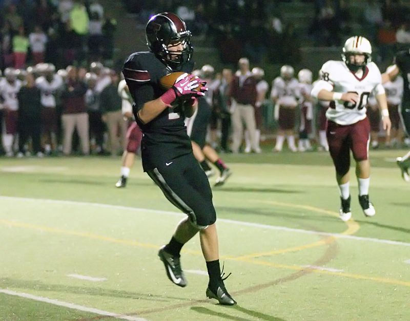 by: DAN BROOD - IN THE OPEN -- Tualatin senior Connor McCullough pulls in a pass in Friday's game. McCullough also had a pair of interceptions for the Wolves in their 24-3 win over Glencoe.