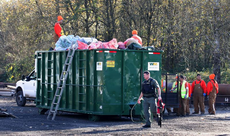 by: OUTLOOK PHOTO: JIM CLARK - More than 10,000 pounds of trash were removed  in the one-day sweep.