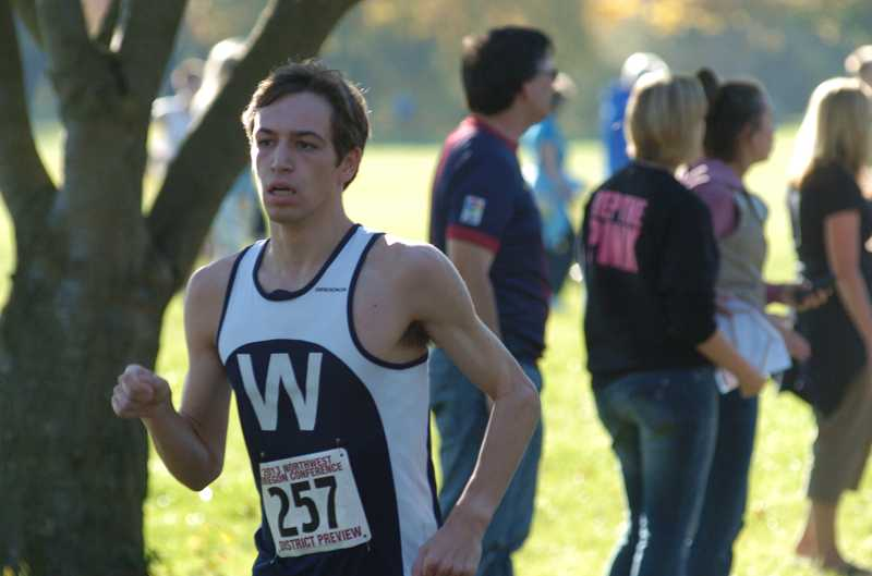 by: PARKER LEE / PAMPLIN MEDIA - Wilsonville junior Josh Meyer placed fourth Oct. 23 at the Northwest Oregon Conference district championships at Blue Lake Regional Park in Fairview. The Wildcats won their fourth-straight NWOC title.