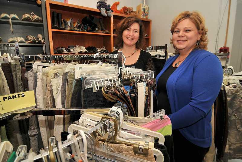by: PAMPLIN MEDIA GROUP: VERN UYETAKE - The Clothes Closet depends on donations for its operating budget as well as its clothing supply. PTA lead Suzanne Dove, left, and Erin Fernald, president of the Clackamas Council PTA, work together to keep the Closet open.