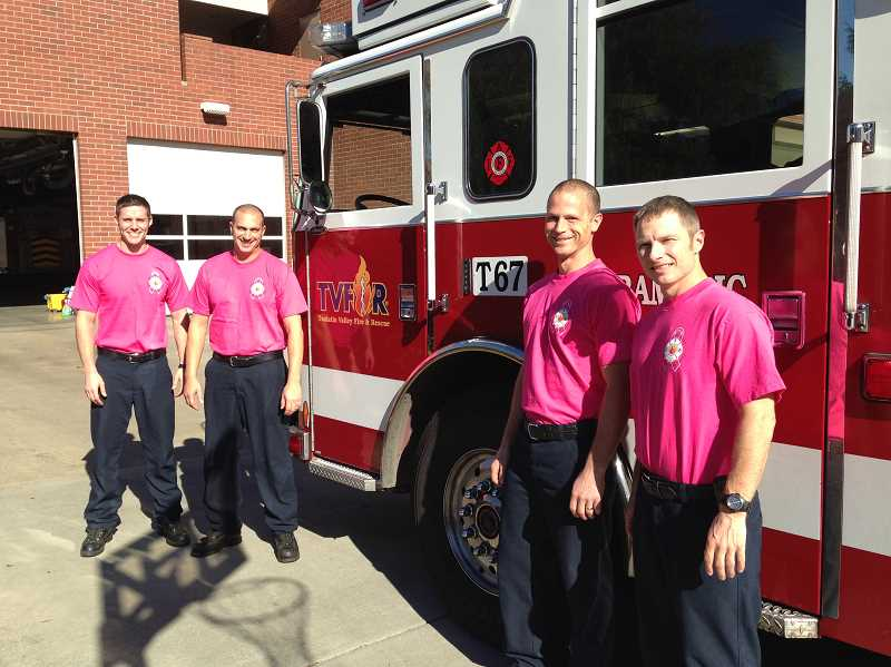 by: TVF&R - Firefighters sported pink T-shirts in honor of Breast Cancer Awareness Month.