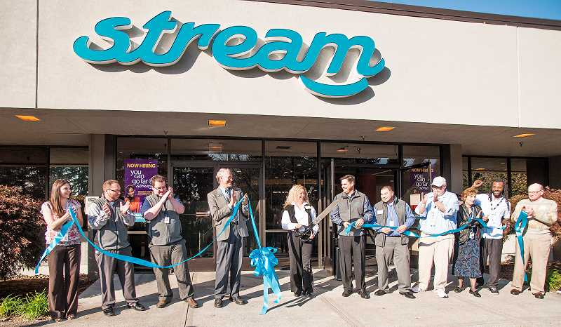 by: JOSH KULLA - Stream executives enjoy a ribbon-cutting ceremony with Stream Wilsonville Site Director Jillene Jensen doing the honors.