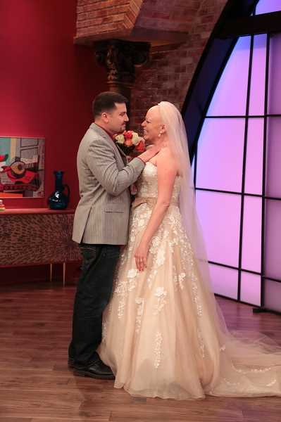 by: THE RACHAEL RAY SHOW - Isn't this romantic? Ryan Conner and Tracie Benjamin look deep into each others eyes when she puts on her wedding dress for the first time.