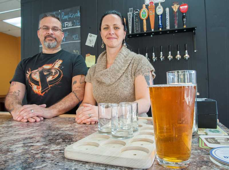 by: JOSH KULLA - Jim and Erin Telles opened The Beer Station in Wilsonville in part to offer beer drinkers a coffee shop-style atmosphere to sample craft brews like this pint of Mazama Brewings Belgian Blonde.