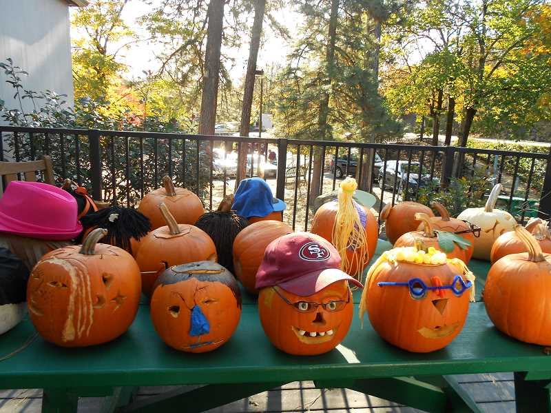 by: SUBMITTED  - Three Rivers Charter School displayed students' pumpkin self-portraits outside the school.