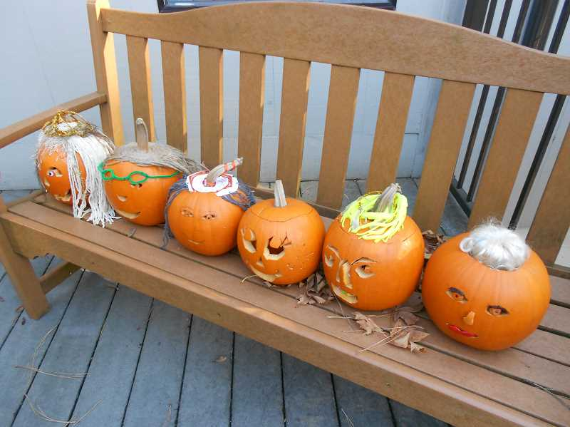 by: SUBMITTED  - A bench outside Three Rivers Charter School provides a display area for students pumpkin self-portraits.