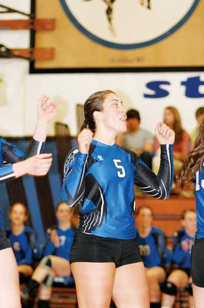 by: PHIL HAWKINS - St. Paul senior Jessica Wilmes celebrates after a point against Falls City in the Bucks final regular season game Oct. 22.