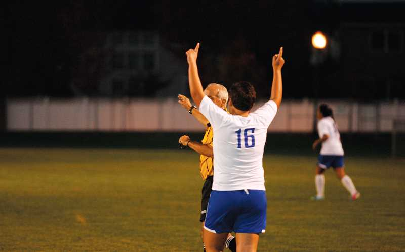 by: PHIL HAWKINS - Woodburn junior Alyssa Castro celebrates her first-half goal in the Bulldogs 1-1 draw against Crescent Valley Oct. 22.