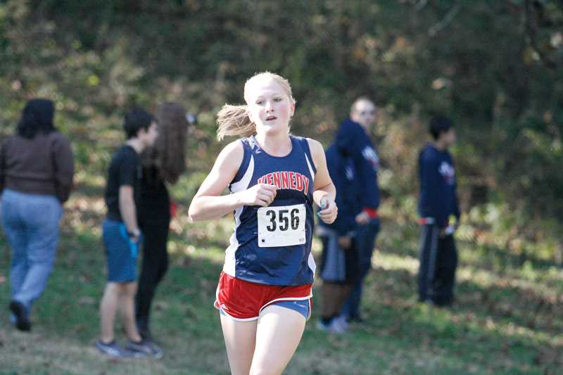 by: PHIL HAWKINS - Trojan cross country runner Lauren Stokley won the Special District 2 Runner of the Year award after placing first at Thursdays district championship for her fourth win of the 2013 season.