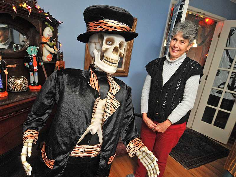 by: VERN UYETAKE - Suzanne Price of Lake Oswego has transformed her home into a Halloween haven for nearly 40 years.