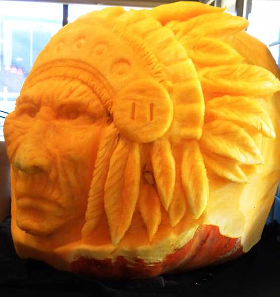 by: SUBMITTED - Others around town are also showing their Halloween spirit. Kerry Sisk of Picasso Artistic Salon was inspired by a History Channel show about Native Americans to carve this pumpkin.