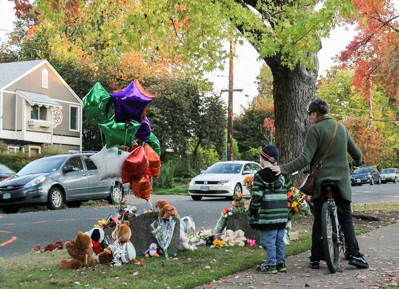 by: NEWS-TIMES PHOTO: JOHN SCHRAG - The memorial to Anna, Abby and their parents started Monday, Oct. 21, the day after the accident (above) and grew quickly each day after that. By Thursday afternoon (below), it held more than 100 balloons and more than 130 stuffed animals.