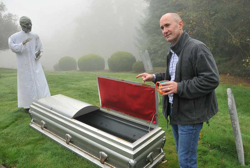 by: TIDINGS PHOTO: VERN UYETAKE - Matthew Knowles found a hollowed-out coffin on Craigslist to add to his collection.