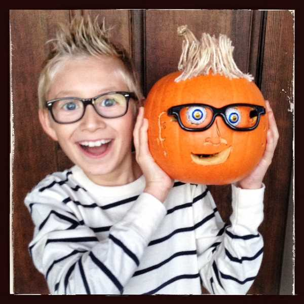 by: SUBMITTED - Ian Roane poses for a photo with his self-portrait pumpkin, which was one of the victims of criminal mishchief at Three Rivers Charter School.