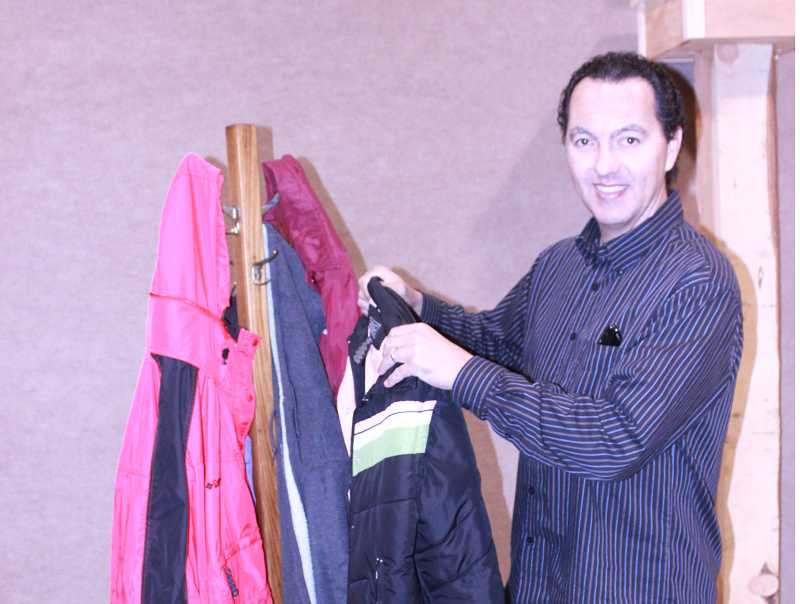 Culver Christian Pastor Al Detres shows some of the coats collected for homeless students.