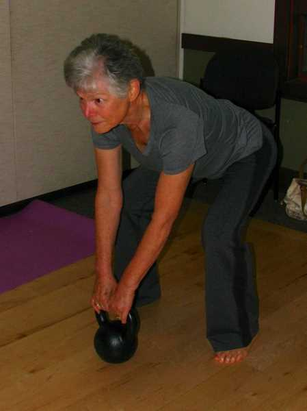 by: SUBMITTED PHOTO:  - Earlene Beko works out with a kettlebell.