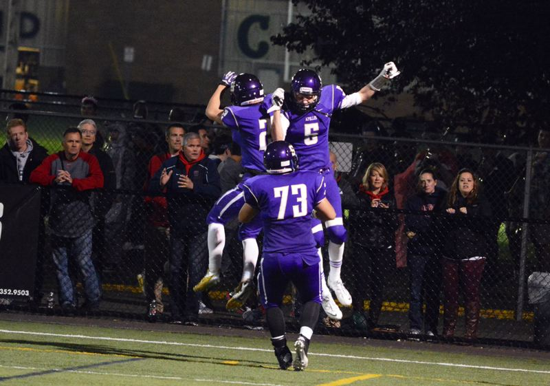 by: TIMES PHOTO: MATT SINGLEDECKER - Sunset wide receivers Jeff Bieber and Matt Burton celebrate Bieber's 22-yard touchdown catch in the second quarter of the Apollos win over Westview.