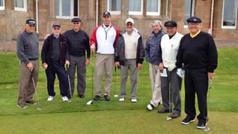 by: COURTESY OF ROB LINDSEY - READY FOR THE FAIRWAYS - The group of golfers takes a moment to pose on the practice putting green at Royal Troon Golf Club: (from left) Pat Shute, Larry Launder, Larry Comstock, Rob Lindsey, Larry Smith, Bob Jannuzi, Rod Sacconaghi and Bill McRivette.