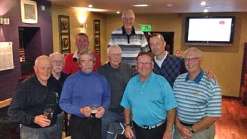 by: COURTESY OF ROB LINDSEY - THROWING BACK SOME PINTS - The entire group, including 'seven old guys having fun,' Summerfield golf pro Rob lindsey and the group's guide, David, share some drinks at Greyfriar's Pub at St. Andrews.