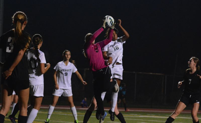 by: TIMES PHOTO: MATT SINGLEDECKER - Beaverton goalie Kylee Coon and Jesuits Lexi Frey go up for a corner kick in the first half of the Crusaders 1-0 win over the Beavers.